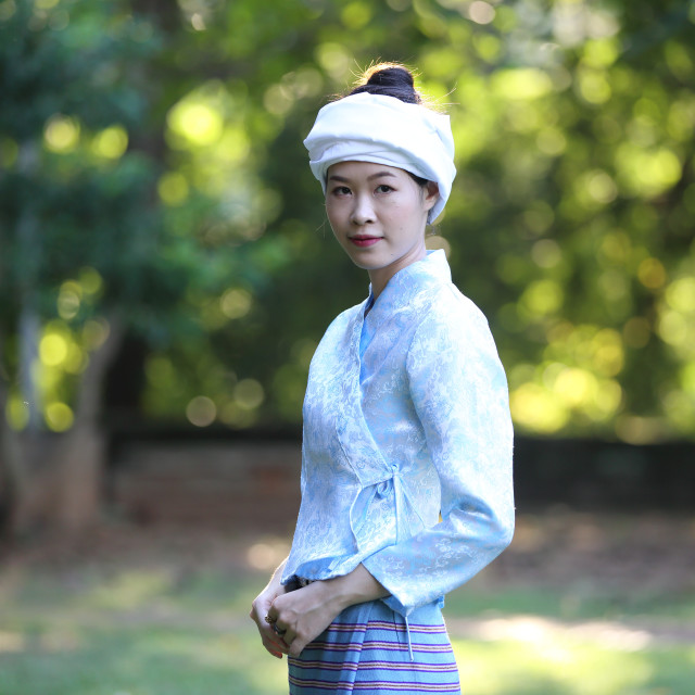 """""""Thai woman wearing traditional Thai dress with old temple background"""" stock image"""