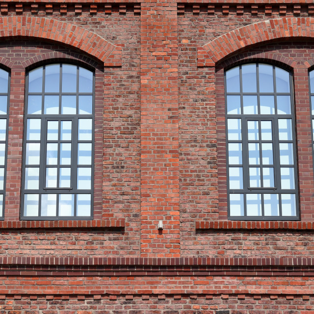"""Windows from an old red brick building"" stock image"