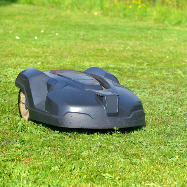 """""""robotic lawnmower on the grass in garden"""" stock image"""