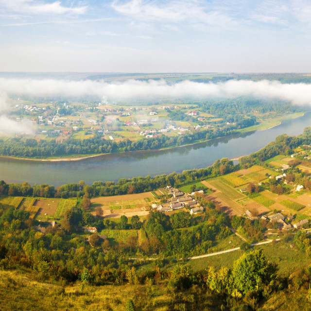 """""""Beautiful panorama of river canyon. Morning fog over the village in valley"""" stock image"""