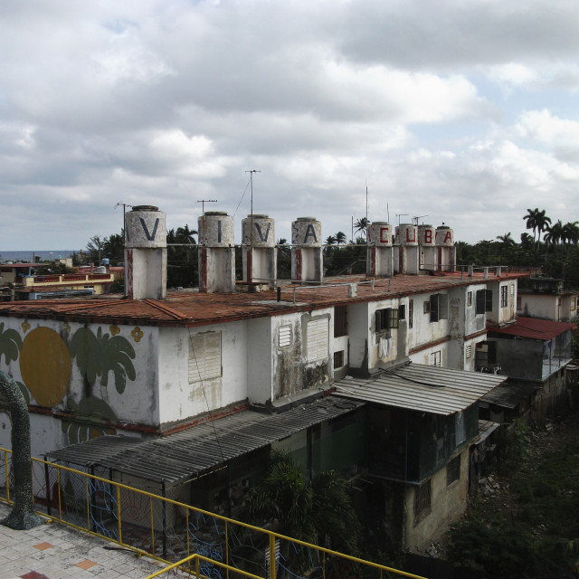 """""""Viva Cuba text on water tank against cloudy sky"""" stock image"""