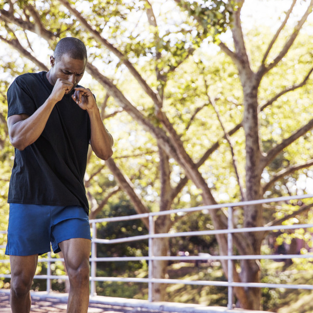 """""""Dedicated male athlete jogging in park"""" stock image"""