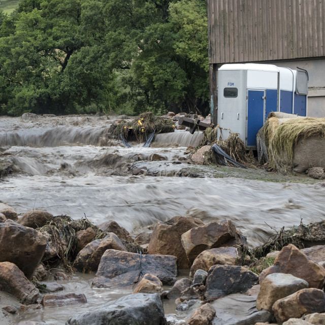 """""""Floodwater Sweeping Through Holme Farm on 30th July 2019, Arkengarthdale, North Yorkshire, UK"""" stock image"""
