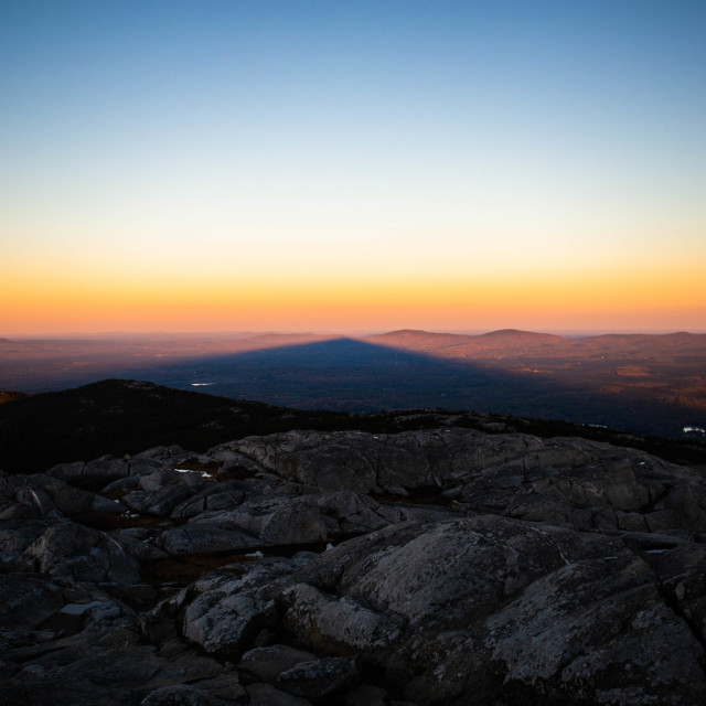 """Shadow of Mt Monadnock over the surrounding landscape at sunset"" stock image"