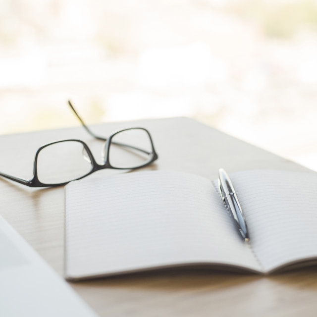 """""""Close-up of diary with pen and eyeglasses on table"""" stock image"""
