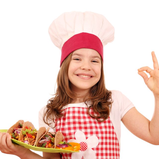 """""""little girl cook with tacos and ok hand sign"""" stock image"""