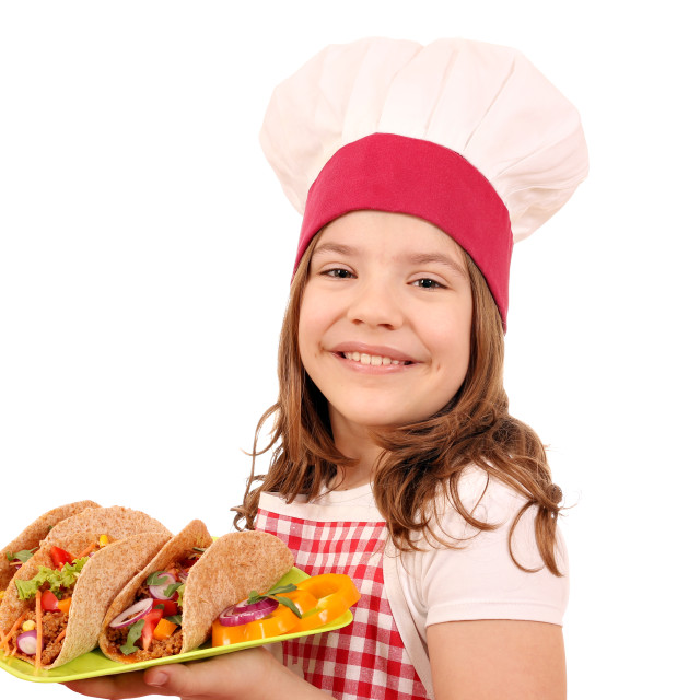 """""""little girl cook with tacos on plate"""" stock image"""