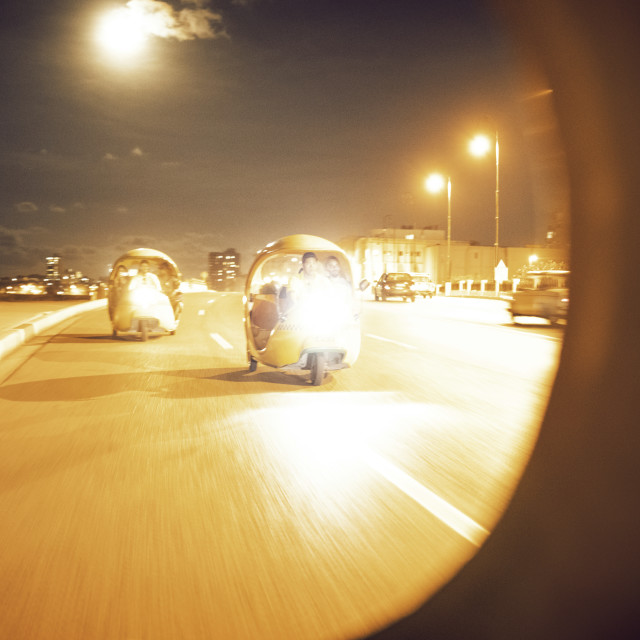 """""""Coco taxies moving on road in city"""" stock image"""