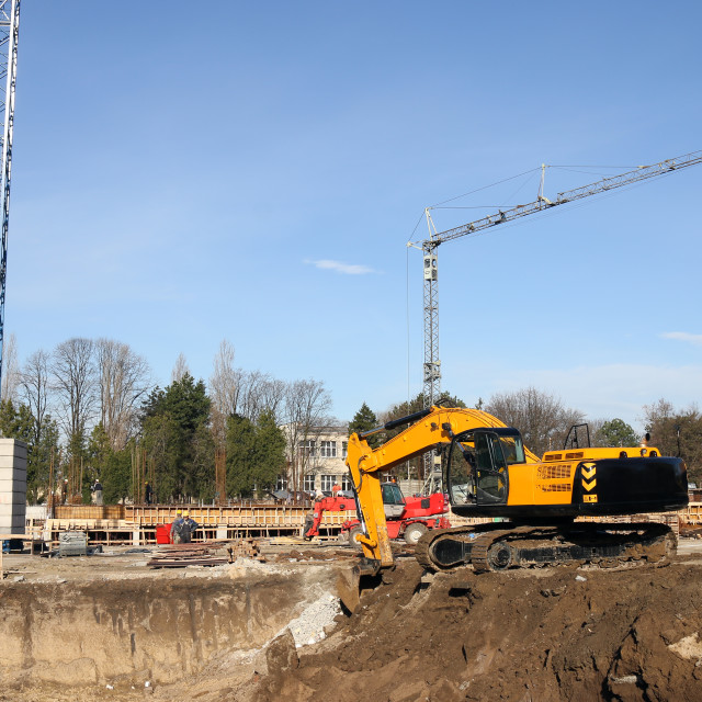"""""""Excavator workers and cranes on construction site"""" stock image"""