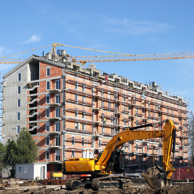 """""""Excavator on new building construction site"""" stock image"""