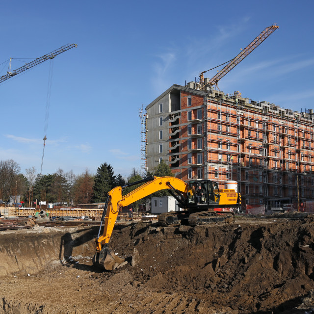 """""""The excavator digs the foundation on the construction site"""" stock image"""