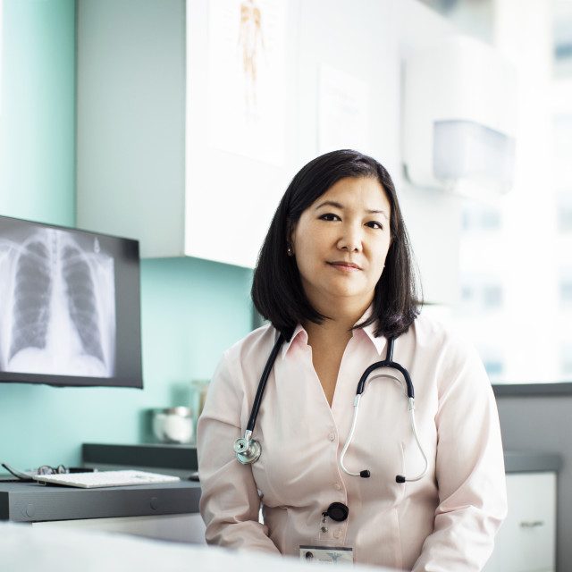 """""""Portrait of confident female doctor sitting in clinic"""" stock image"""