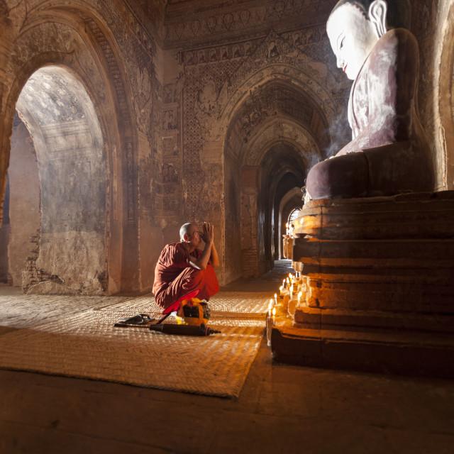 """""""2858 - Bagan: Paya Thone Zu, enlightened buddha and praying monk"""" stock image"""