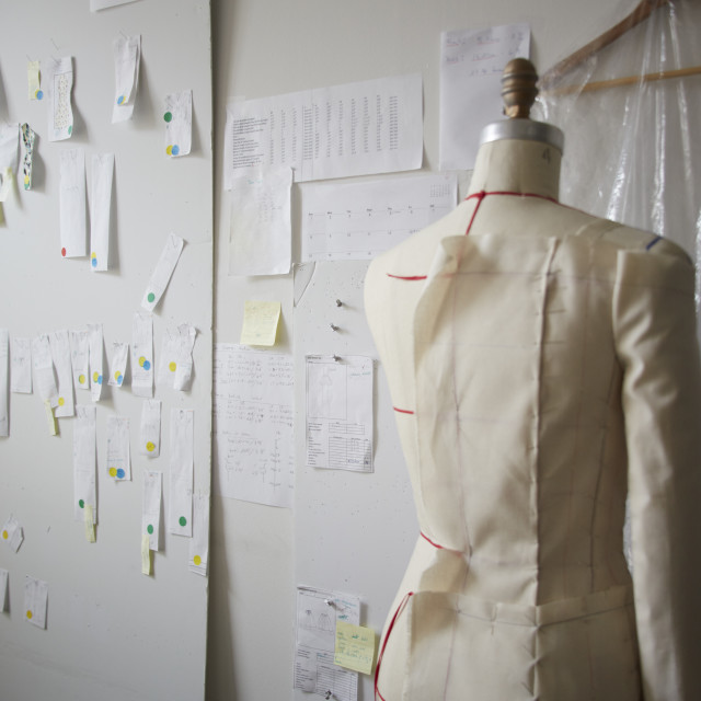 """""""Mannequin by papers on wall in workshop"""" stock image"""
