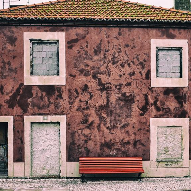 """""""Red House with Bricked in Windows"""" stock image"""