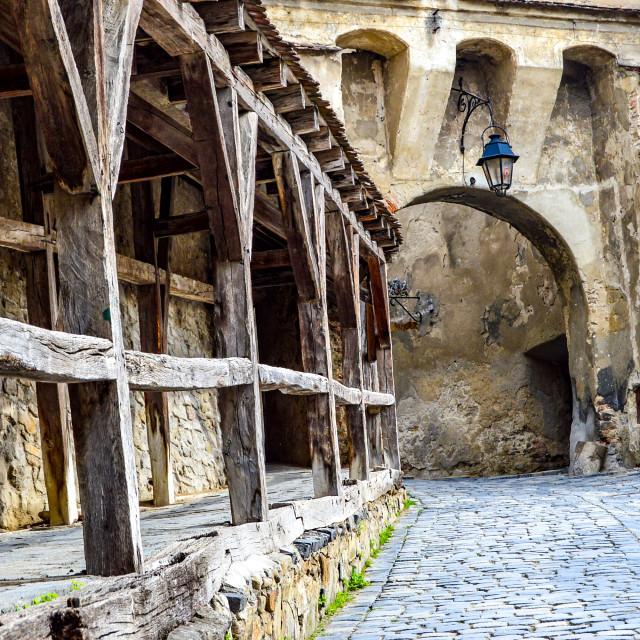 """Arch and Wooden Rails In Sigishoara, Romania"" stock image"