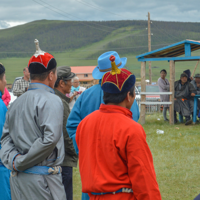 """""""Watchful Contestents of Naadam Wrestling Matches"""" stock image"""
