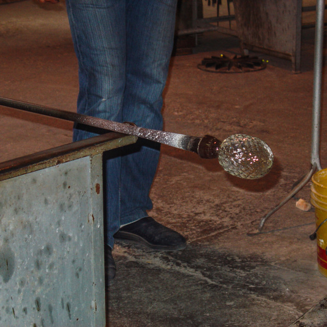 """""""Glass Blower Rolling Heated Glass For Shaping In Venice Italy.jpg"""" stock image"""