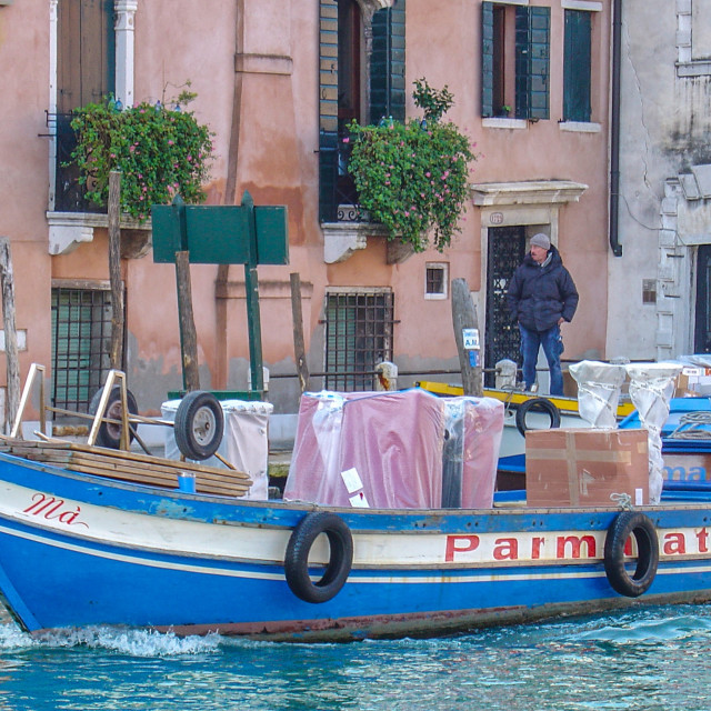 """""""Boat Making Deliveries In Canals of Venice, Italy"""" stock image"""