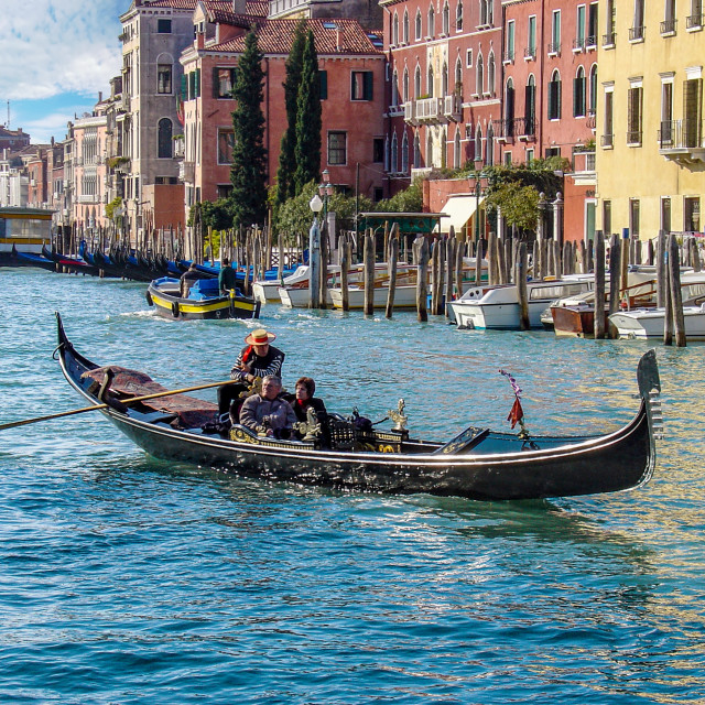 """""""Gondolier with Tourists In Venice Grand Canal"""" stock image"""