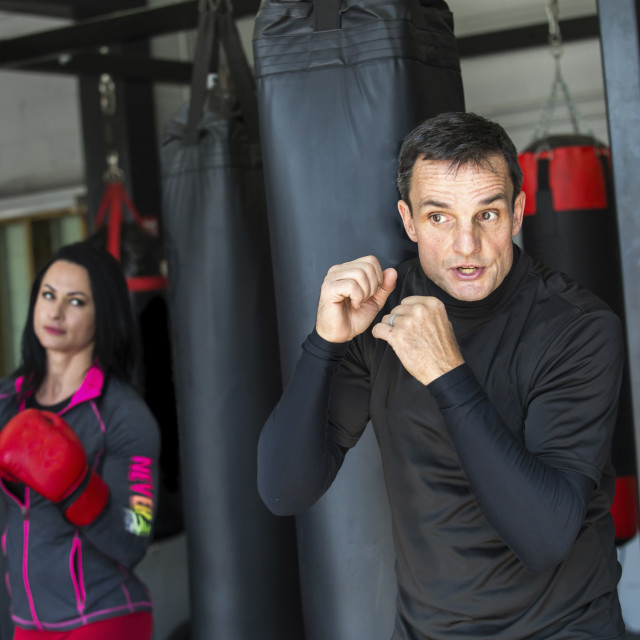 """""""Coach training female boxer in gym"""" stock image"""