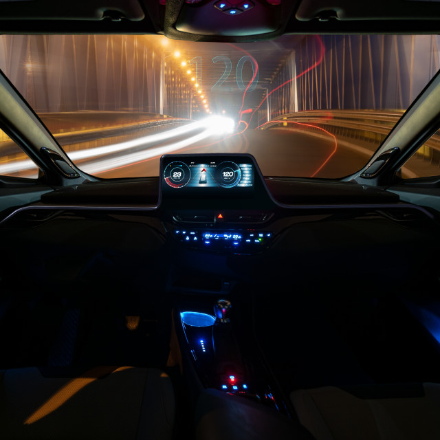 """vision of an autonomous car driving at night in a lighted tunnel."" stock image"