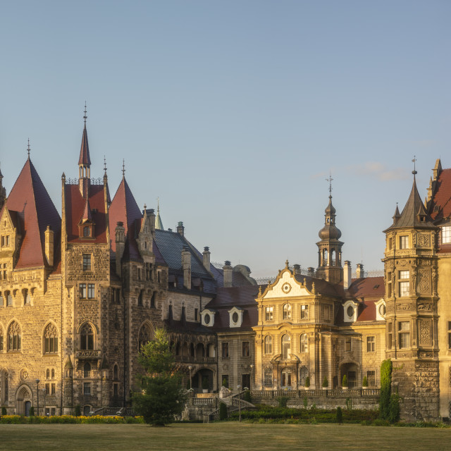 """Castle in Moszna in the rays of the rising sun, near Opole, Silesia, Poland."" stock image"