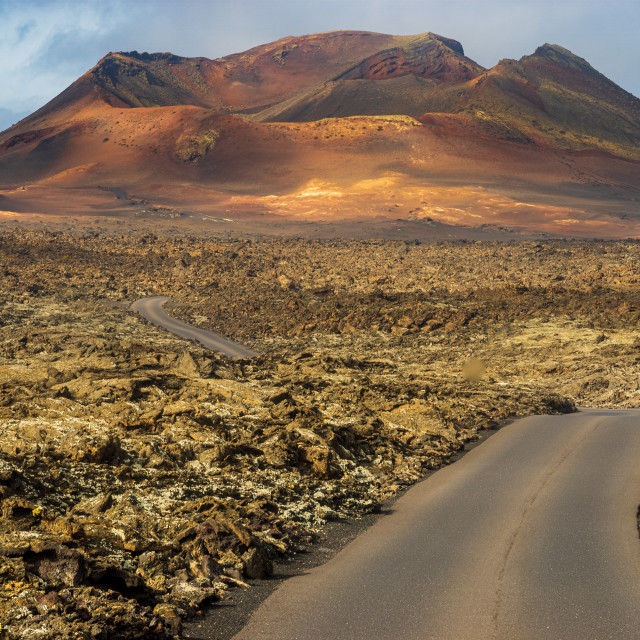 """road running among volcanoes in Timanfaya National Park, Lanzarote"" stock image"