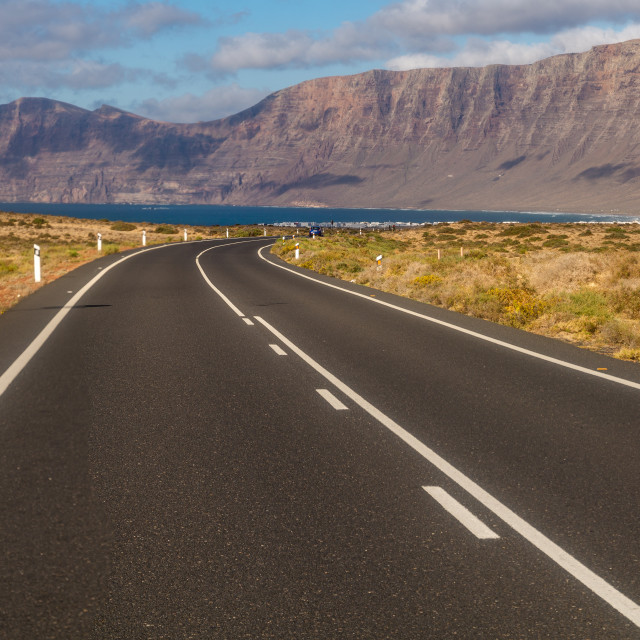 """Tourist, scenic road to Lanzarote, leading to the ocean"" stock image"