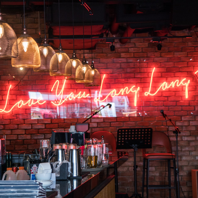 """""""Bar with humorous neon sign"""" stock image"""