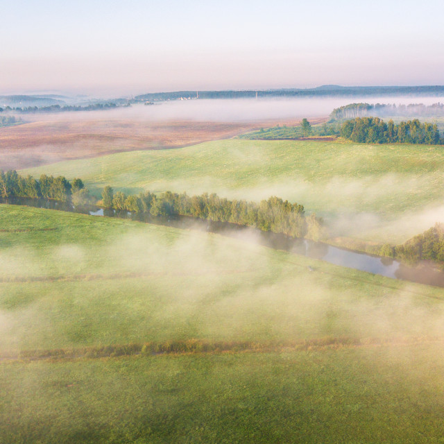 """""""Morning fog over river, meadow and forest. Nature sunlight scene"""" stock image"""