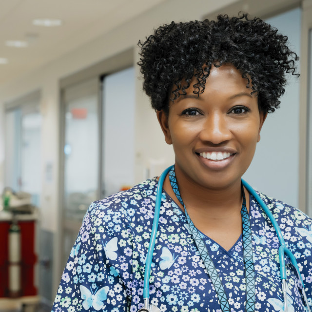 """""""Portrait of confident female doctor in hospital lobby"""" stock image"""
