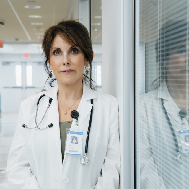 """""""Portrait of confident female doctor standing in hospital lobby"""" stock image"""