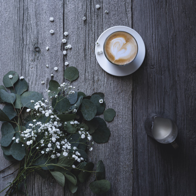 """""""Overhead shot coffee latte with milk jug and herbs on rustic table"""" stock image"""