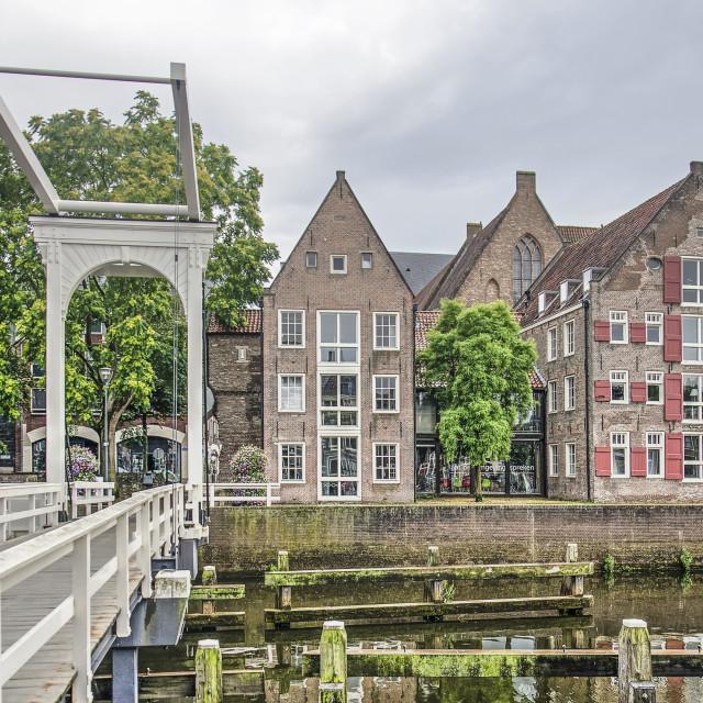 """Historic drawbridge and houses"" stock image"