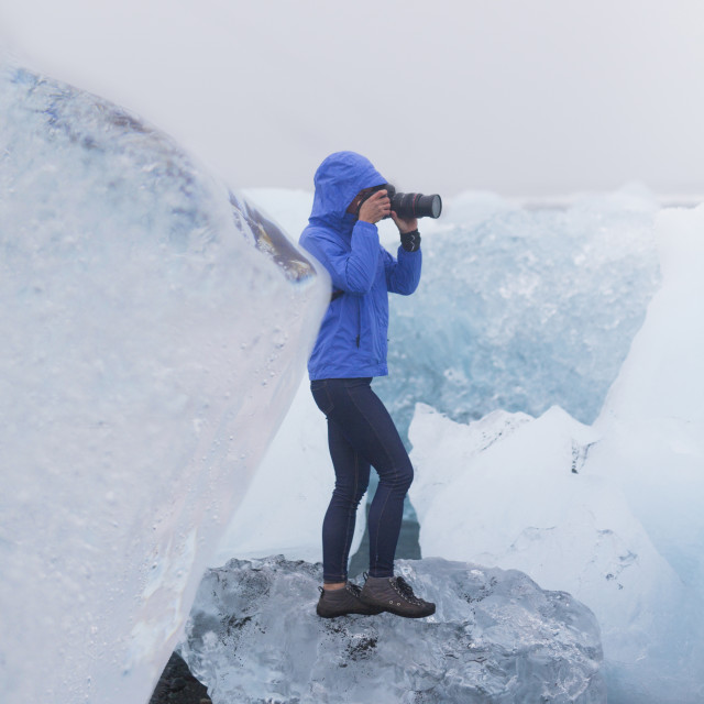 """""""Full length of female tourist photographing with camera while standing on..."""" stock image"""