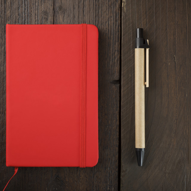 """""""Overhead view of diary with pen on wooden table"""" stock image"""