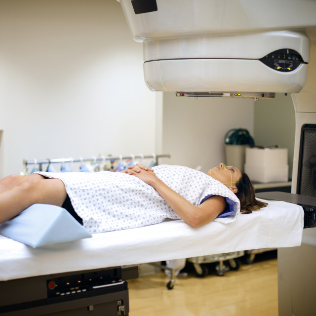 """Female patient getting X-ray examination in hospital"" stock image"