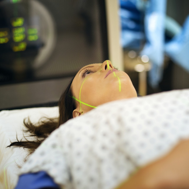 """High angle view of woman lying on examination table"" stock image"