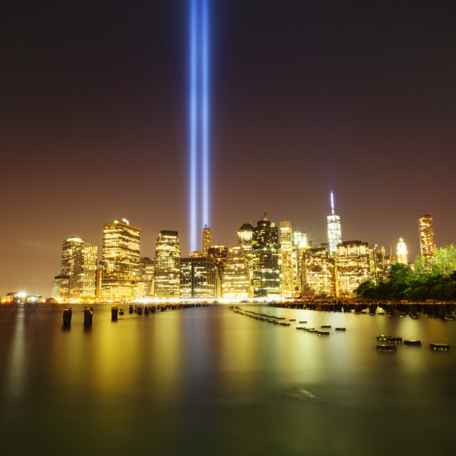 """""""Idyllic view of river and illuminated city with Tribute in Light at night"""" stock image"""