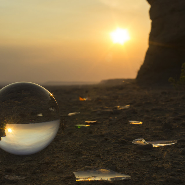"""""""Sun shining over sea shore reflection on crystal ball during sunset"""" stock image"""