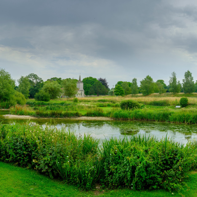 """St Michael's Church and village pond in Stoke Charity, Hampshire"" stock image"