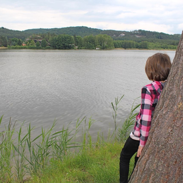 """Girl looking at the lake"" stock image"