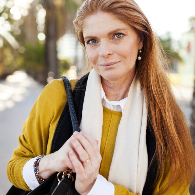 """""""Portrait of confident mature woman with purse in city"""" stock image"""