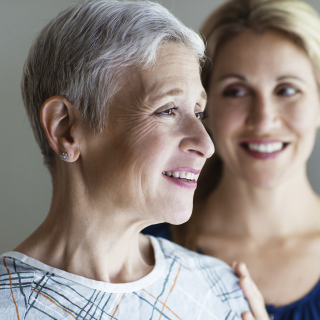 """""""Daughter consoling mother in hospital"""" stock image"""