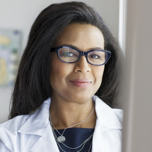 """""""Portrait of confident female doctor standing in hospital"""" stock image"""
