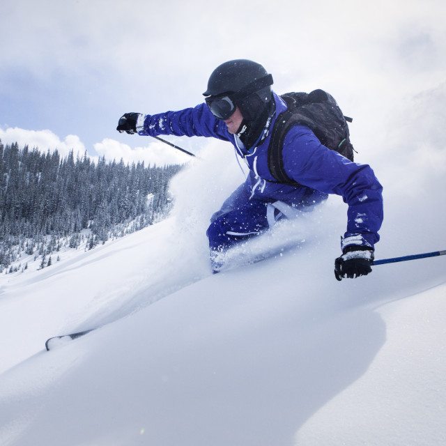 """""""Skier on snow covered mountain against sky"""" stock image"""