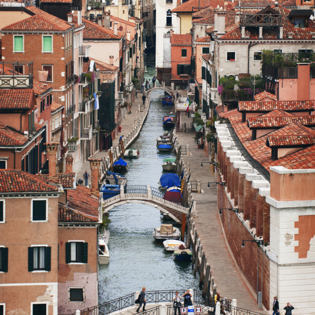 """""""High angle view of boats moored at channel amidst buildings in city"""" stock image"""