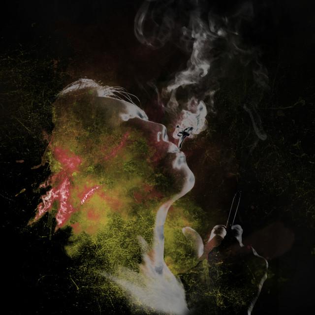 """smoking woman in yellow tones"" stock image"