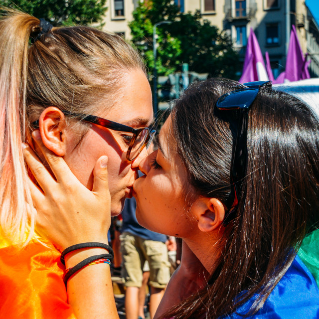 """""""Women kissing at gay pride marching claiming for equality and legal rights..."""" stock image"""